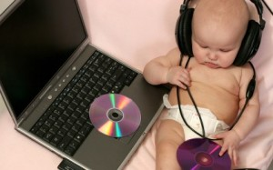 cute-baby-with-laptop-and-listen-music_422_78796