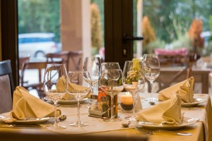 upscale restaurant table with wine glasses and fancy dinnerware